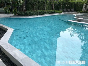 light grey tribeca pool tiles in swimming pool
