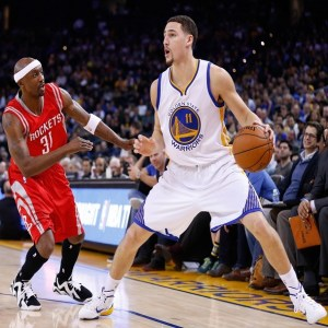 Jan 21, 2015; Oakland, CA, USA; Golden State Warriors guard Klay Thompson (11) prepares to shoot the ball in front of Houston Rockets guard Jason Terry (31) during the fourth quarter at Oracle Arena. The Warriors won 126-113. Mandatory Credit: Kelley L Cox-USA TODAY Sports