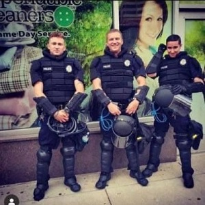 "Tommy McClay, a Denver police officer, makes fun of the protests, with his Instagram post. He took a photo with two other officers, but was controversial with his caption. This caption reads ""let's start a riot,"" making light of what is going on around the country."