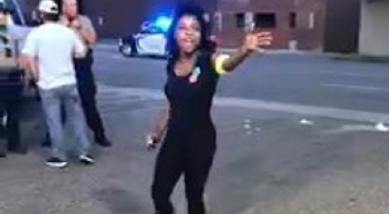 """Lyndon C Palmer has gone viral, with a video he shared on Facebook. The video shows a young, black, woman clearly upset, as she is screaming, exiting an ice cream parlor. According to her comments, she was trying to place an order, and she was ignored twice, so she brought up race, and was asked to leave, prompting her to curse, saying the word """"f*ck,"""" to which a white man told her not to curse in front of his nine-year-old daughter, which only made the woman more upset. The police were called, with reports of a fight soon to break out, as the woman continued to state her peace, telling the men they were racist, as five police officers arrived on the scene, where she also explained to them what happened. Despite telling her he understood, the officer told her to leave the premises, within five minutes, or he would arrest her, telling her to cross the street. As she left, she waited before crossing the street, as a car was coming, so the Durham police officer ended up arresting her, in all of about thirty seconds, arresting her for trespassing."""