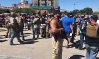 White militia assemble in Louisville, KY, to confront NFAC Militia. NFAC is in town, protesting for Breonna Taylor. Meanwhile, the white protesters are there to confront them, saying they don't start fights, they end them.