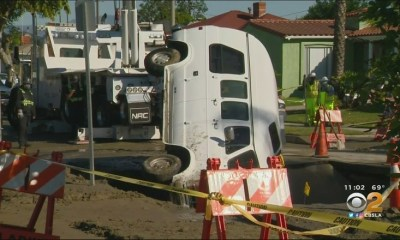 Amber Anderson's van falls into sinkhole, in front of her home in Crenshaw, Los Angeles.