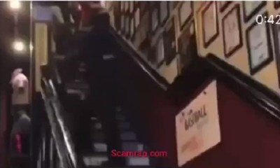 Black woman gets dragged down staircase by security guard
