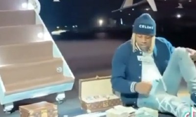Lil Durk counts 1 million dollars cash in front of private jet