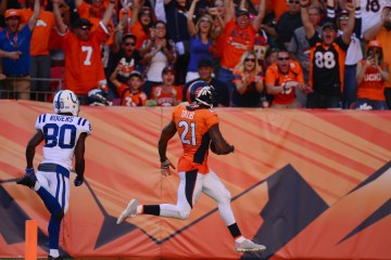 DENVER, CO - SEPTEMBER 18:  Cornerback Aqib Talib #21 of the Denver Broncos intercepts the ball and scores a touchdown in the fourth quarter of the game against the Indianapolis Colts at Sports Authority Field at Mile High on September 18, 2016 in Denver, Colorado. (Photo by Dustin Bradford/Getty Images)