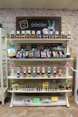 Photo of a rack of handmade soap and skinscare products from Lolablue, a local North Port company.