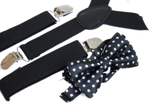 Zwarte bretels en een zwarte vlinderstrik met witte stippen voor kinderen.