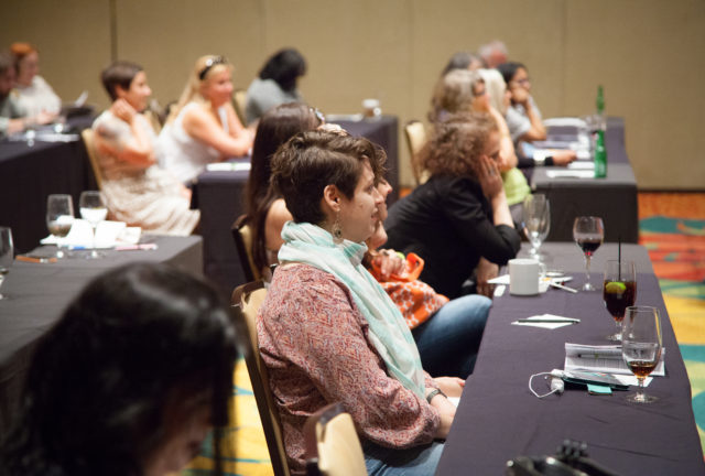 attendees listening to speaker