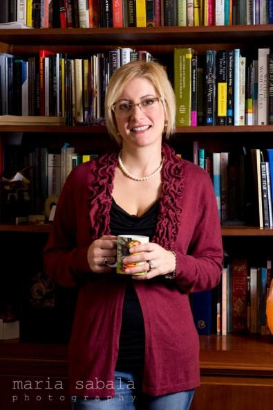 lara lillibridge with coffee by bookshelf