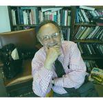 alvin burstein in office with books