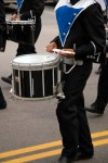 close up of snare drum player in marching band