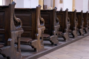 close up of old style wodden church pews