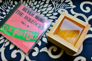 sex pistols CD and wooden box of sake