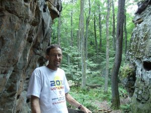 nathan leslie on trail in woods
