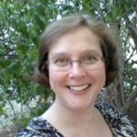 elizabeth webb in glasses in front of trees