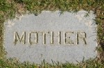 """Mother"" inscription on gravestone flat in ground"