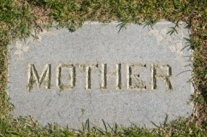 """""""Mother"""" inscription on gravestone flat in ground"""