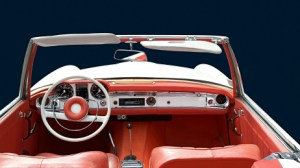 interior of an old convertible looking from backseat to steering wheel