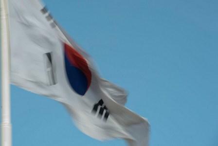 korean-flag against clear sky waving