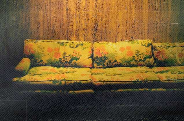 old couch with green and orange flowers