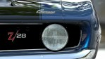 blue camaro close up of headlight and hood