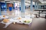 uneaten food on school lunch tray