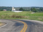 rural ohio road, curve with farm in backgroud