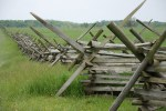 battlefield with wooden fence in middle - gettysburg pa