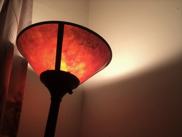 lamp on shining on ceiling leaving a soft glow