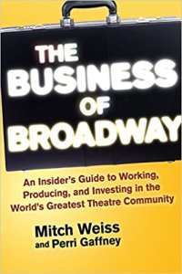 business of broadway written inside of a briefcase with authors names beneath