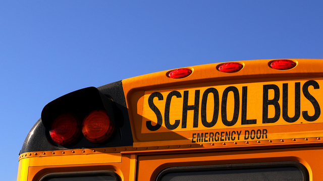 school bus back - close up of top against bright blue sky