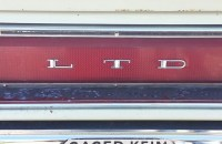 close up of LTD letters on bumper/taillight of old car