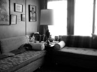 author's grama's couch - retro, round pillos, pics on wall, lamp