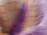 abstract shadowy image of a woman in a scarf, but it almost looks like a wave of water