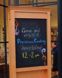 chalkboard announcing pressure cooker demo