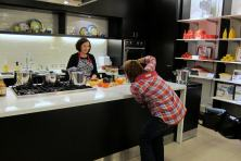 Professional photographer taking photos for the cover of the upcoming hip pressure cooking cookbook during pressure cooker demo at Bloomingdale's San Francisco