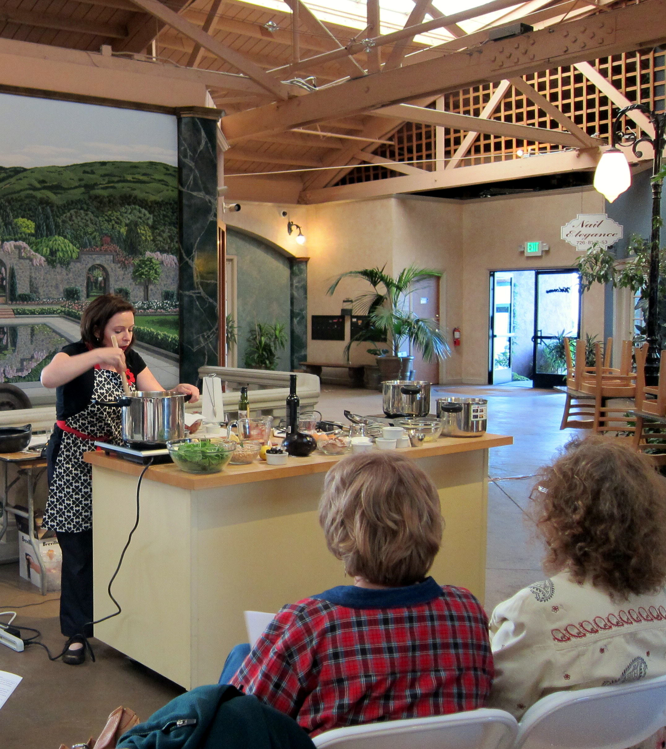 Founder of hip pressure cooking sautees an onion for cooking class