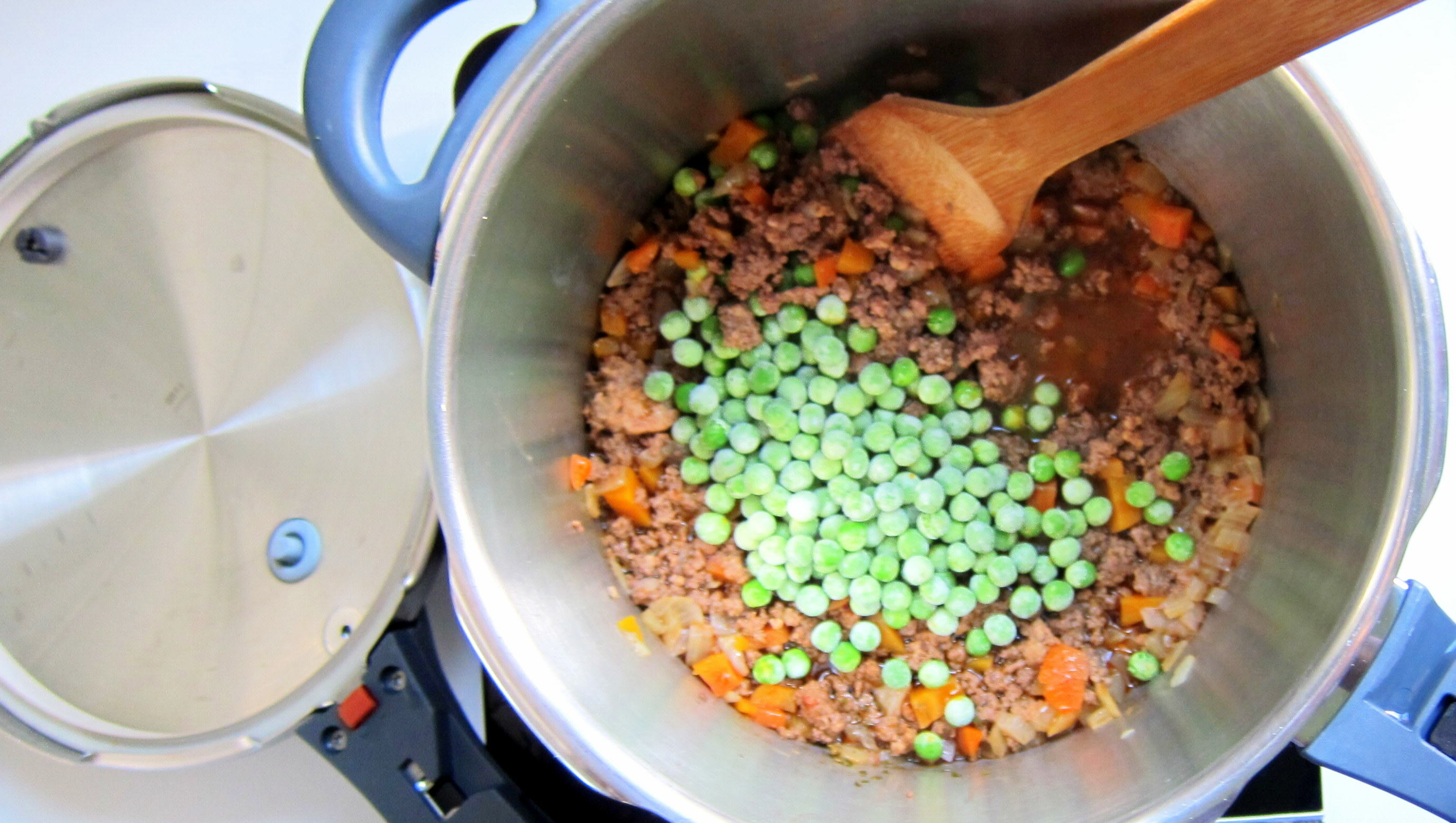 After pressure cooking, toss in the frozen pease and mix into the hot meat sauce.