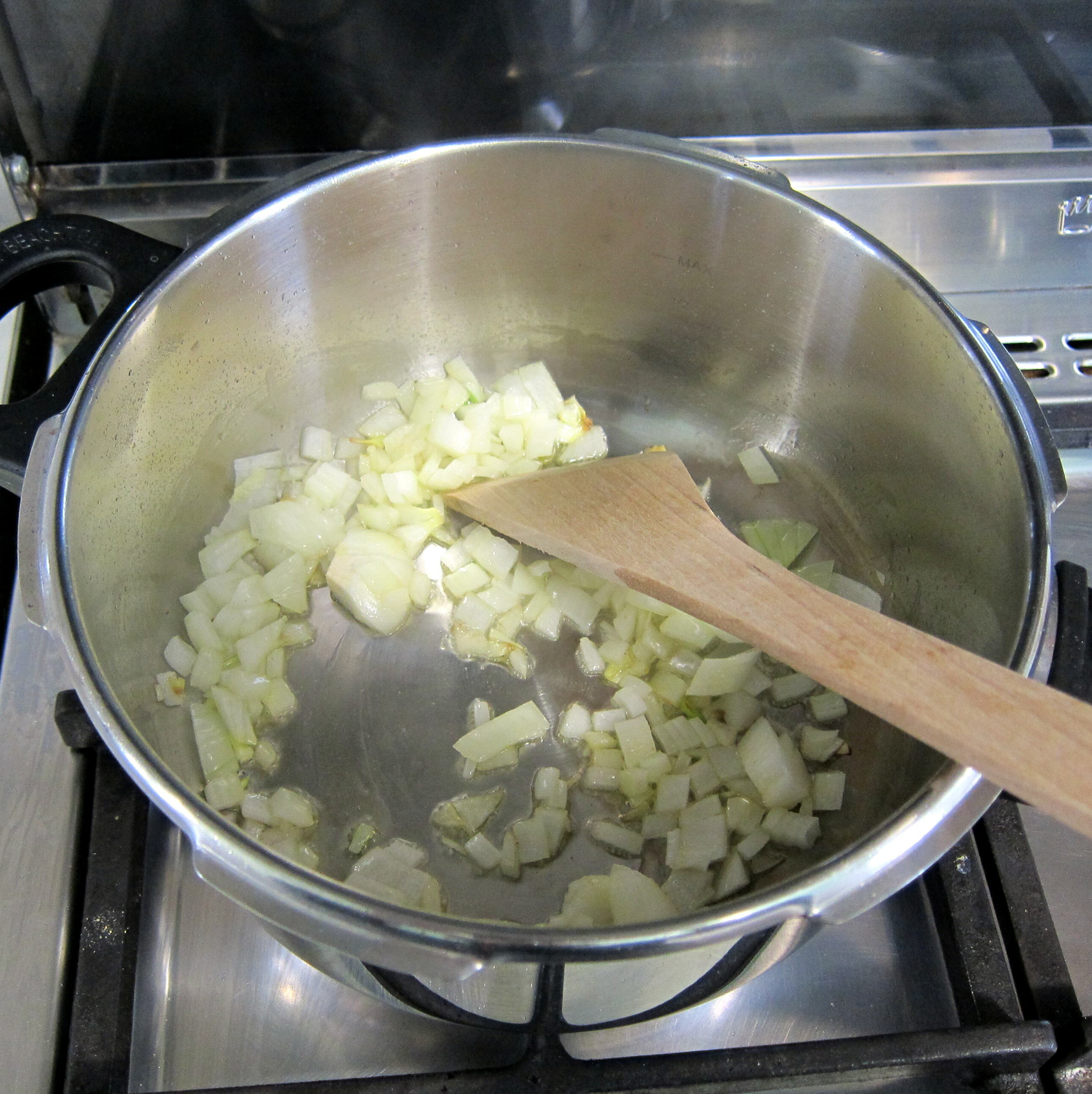 In small pressure pan add oil onion and saute until softened.