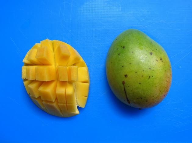 Slice mango in half and score the flesh.