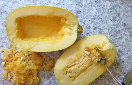 Slice squash in half and scoop out the seeds.