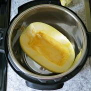 Place squash halves face-up in pressure cooker with water.
