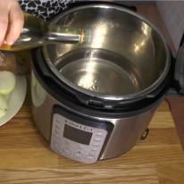 Add water and vinegar to the pressure cooker.
