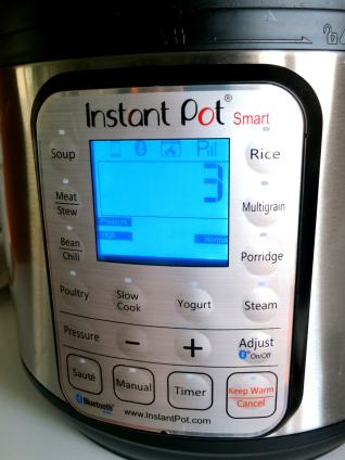 Instant Pot SMART display with extra status icons.