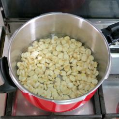 Pre-cook the hominy in water.