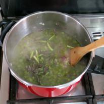 Add asparagus micro stock, salt and tips.