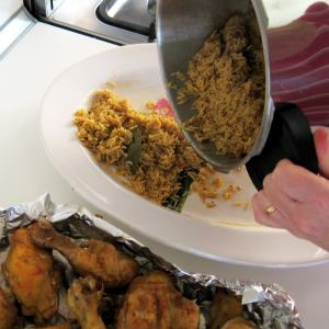 Layer rice, chicken, garnish and cooking liquid on platter before serving.
