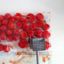 Smash cherry tomatoes open.