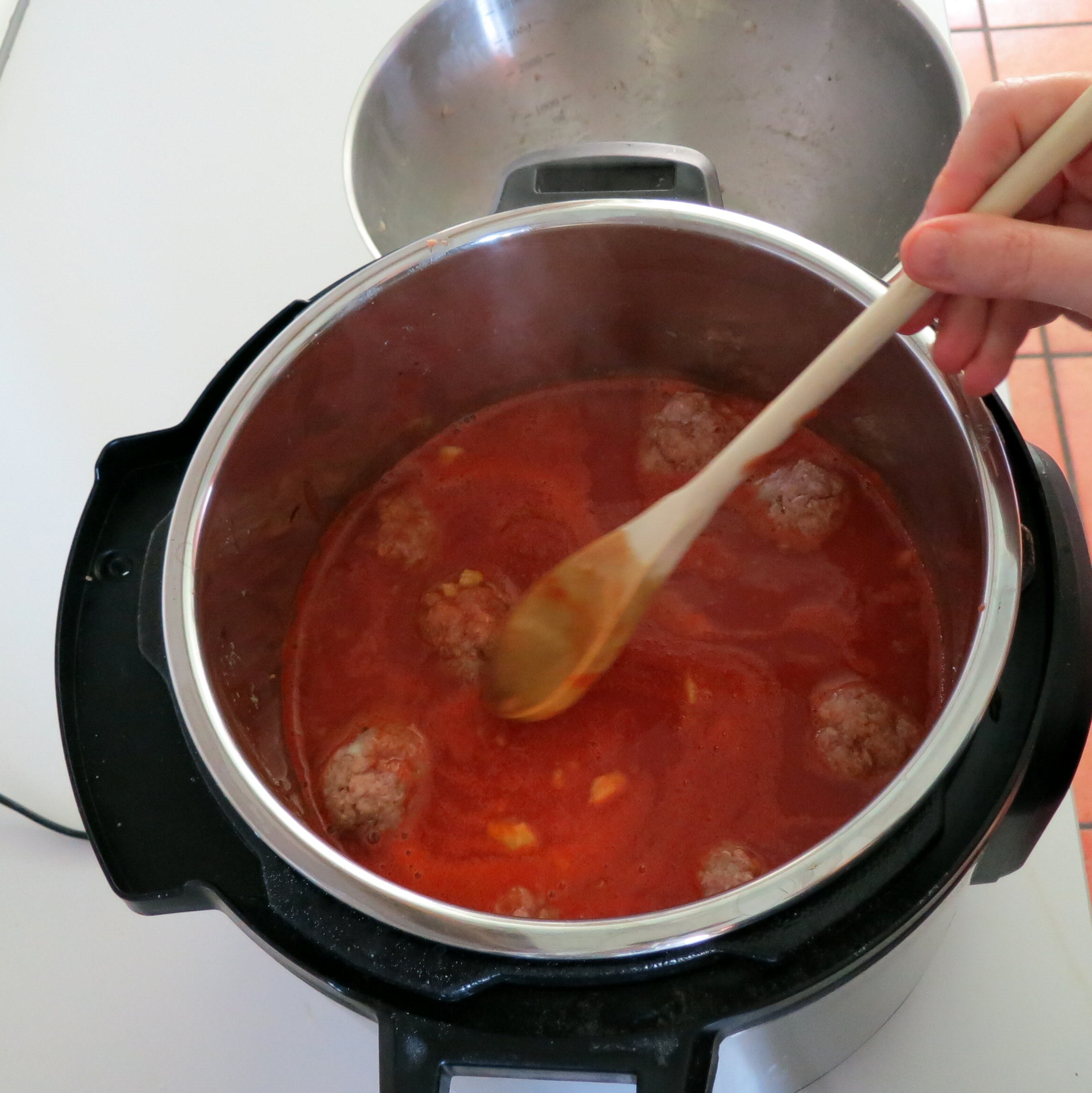 Flick some hot tomato sauce onto the uncovered meatballs
