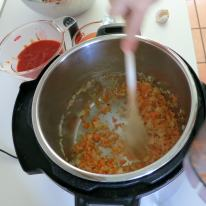 Add carrots and celery to softened onion